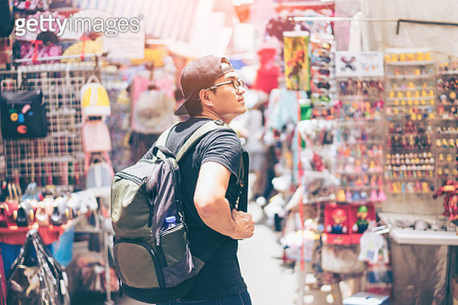 Young man traveler is visiting at Mongkok in Hong Kong. - gettyimageskorea