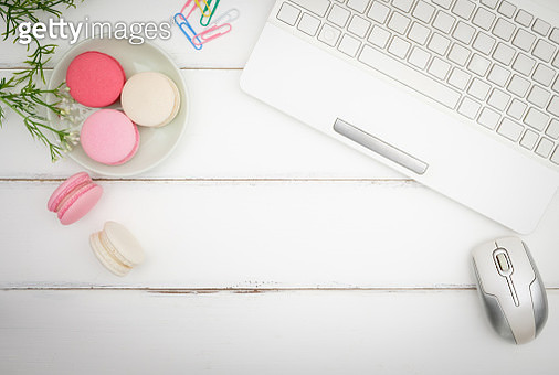 Directly Above Shot Of Macaroons And Laptop On Table - gettyimageskorea
