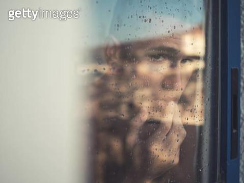 Close-Up Portrait Of Man Seen Through Window - gettyimageskorea