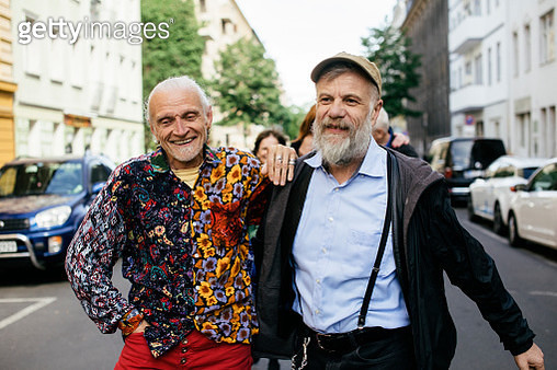 Senior gay men walking together embracing each other on a city street. Part of the LGBTQ Portrait series. - gettyimageskorea
