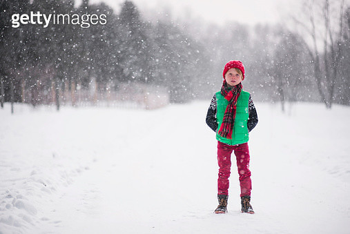 Boy standing in the snow - gettyimageskorea