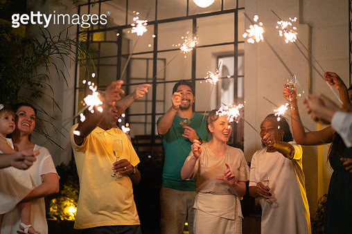 Family and Friends Celebrating New Year Party with Sparkler at Home - gettyimageskorea