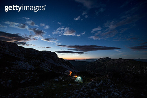 Scenic View Of Mountains Against Sky During Sunset - gettyimageskorea