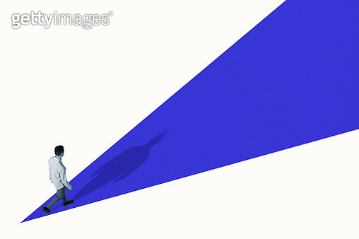 High angle view of young man walking on blue ramp - gettyimageskorea