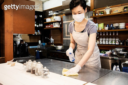 A woman owner disinfects the kitchen before opening - gettyimageskorea