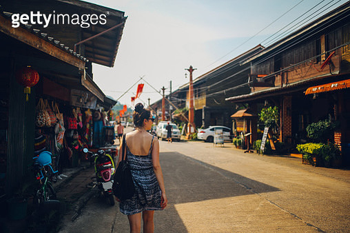 Young woman walking in the Old Town of the Koh Lanta island, Thailand - gettyimageskorea