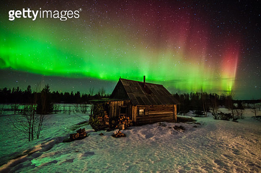 Northern lights above a wooden house in the forest - gettyimageskorea