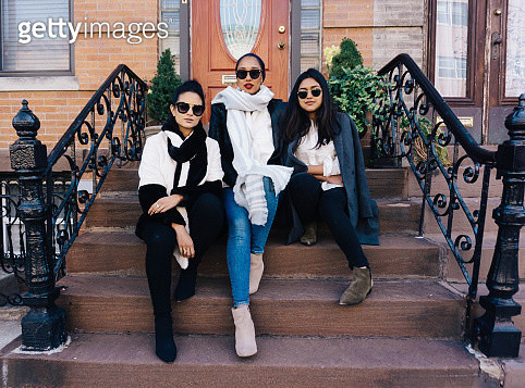 #MuslimGirls Sitting on a Stoop - gettyimageskorea