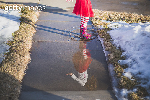 Girl Standing in Puddle - gettyimageskorea