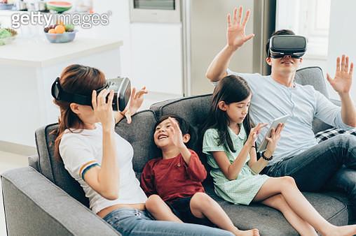 Family having fun with VR simulator - gettyimageskorea