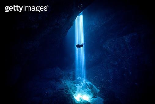 Sunlight Falling On Silhouette Person Scuba Diving Undersea - gettyimageskorea