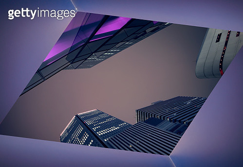 Looking up at modern office buildings at dusk - gettyimageskorea