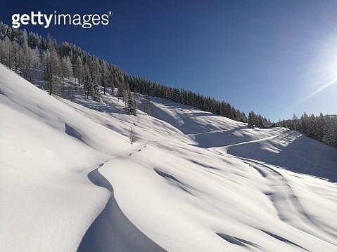 Snow Covered Land And Mountains Against Sky - gettyimageskorea