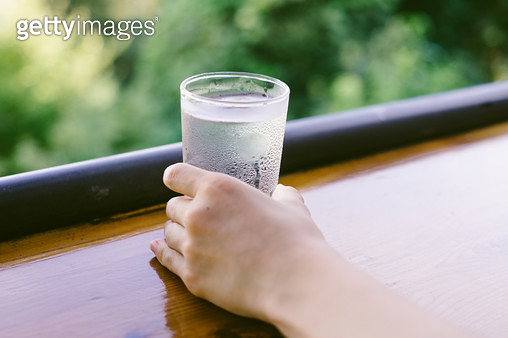 having a drink of water at a mountain hut. - gettyimageskorea