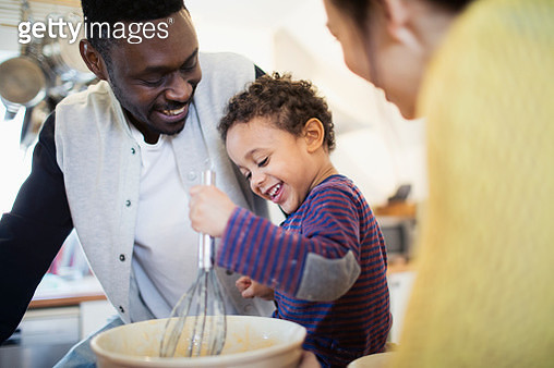 Happy father and son baking in kitchen - gettyimageskorea