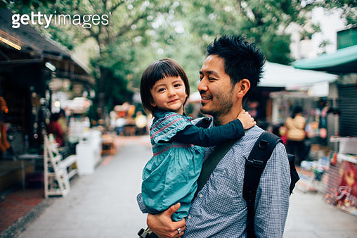 Japanese father holding his adorable mixed race daughter having a fun time - gettyimageskorea