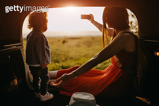 Mother and daughter on a roadtrip taking selfie - gettyimageskorea