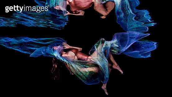 Woman floating in dark water - gettyimageskorea