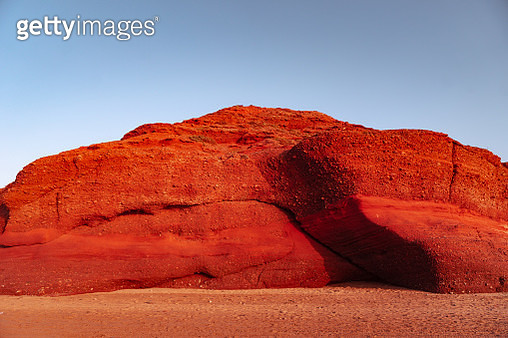 Red rocks on the beach, Plage Sidi Ifni, Morocco, Africa - gettyimageskorea