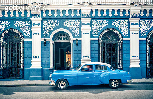 Old vintage car in front of colonial style house, Cuba - gettyimageskorea