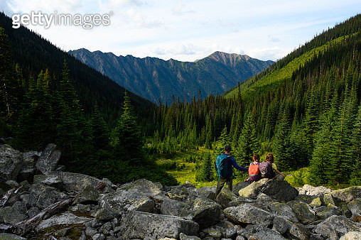 Father with young daughters exploring nature - gettyimageskorea