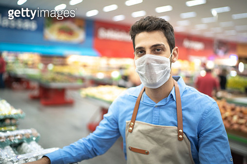 Portrait of young business man owner with face mask at supermarket - gettyimageskorea