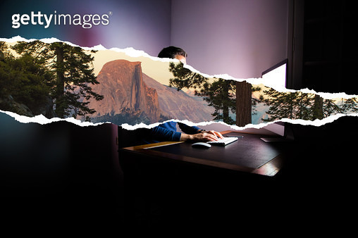 Guy working at night dreaming about nature vacations using torn paper effect. - gettyimageskorea
