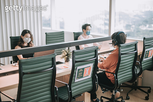 asian chinese white collar worker back to work after quarantine with new SOP and social distancing illness prevention safety precautions - gettyimageskorea