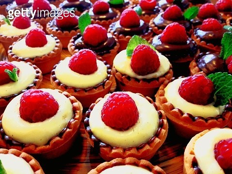 Close-Up Of Strawberry Tarts On Table - gettyimageskorea