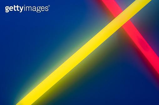 Glow Sticks Crossing on Deep Blue - gettyimageskorea