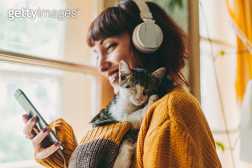 Woman staying home is talking on video call - gettyimageskorea