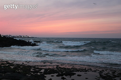 Scenic View Of Sea Against Sky During Sunset - gettyimageskorea