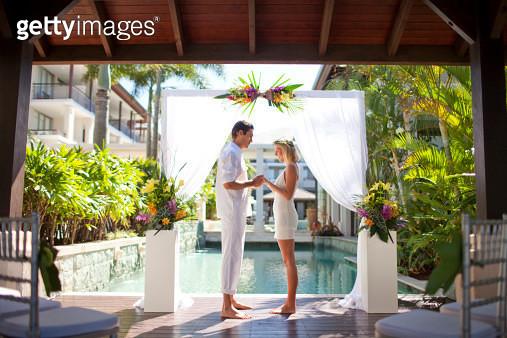 Bride and Groom at resort wedding ceremony - gettyimageskorea