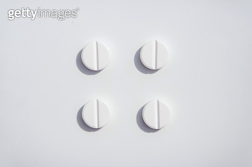 High Angle View Of Pills On White Background - gettyimageskorea