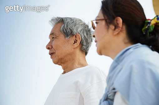 Asian senior man and mature woman together on sunny day - gettyimageskorea