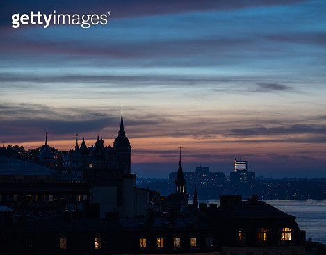 Buildings In City Against Sky During Sunset - gettyimageskorea