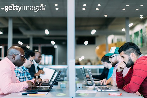 Multi-ethnic group studying, brainstorming, working together or having a business meeting. Startup. Bring your own device area. Open plan - gettyimageskorea