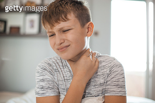 Sore Throat - Boy holding his neck in pain - gettyimageskorea
