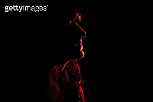 Illuminated profile of womans face - gettyimageskorea
