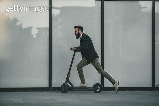 hipster riding a scooter in the city - gettyimageskorea