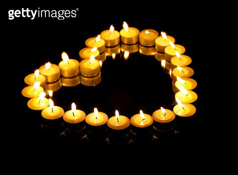 Close-Up Of Burning Candles Against Black Background - gettyimageskorea