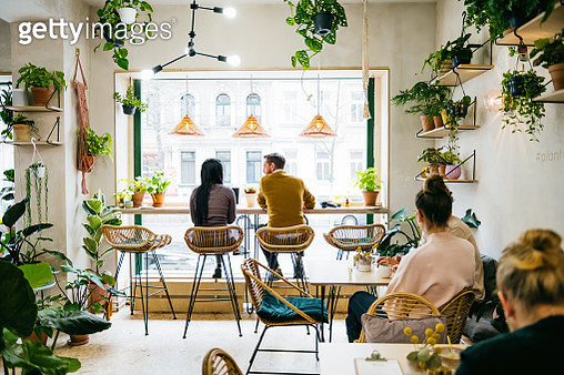 Couple Sitting In Front Of Window In Quirky Café - gettyimageskorea