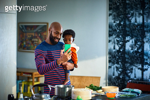 Man with baby son (6-11 months) at home - gettyimageskorea
