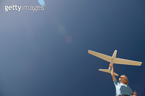Young boy playing with airplane - gettyimageskorea
