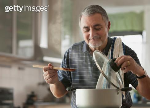 Elderly man cooking - gettyimageskorea