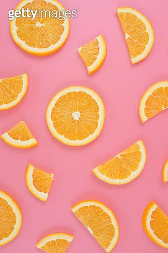 Directly Above Shot Of Orange Slices On Pink Background - gettyimageskorea