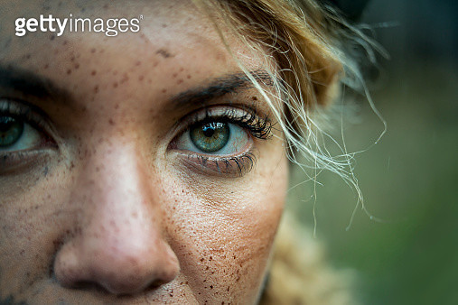 Portrait of a female mountain biker in nature - gettyimageskorea