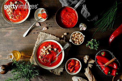Red pepper soup with ingredients on a table - gettyimageskorea