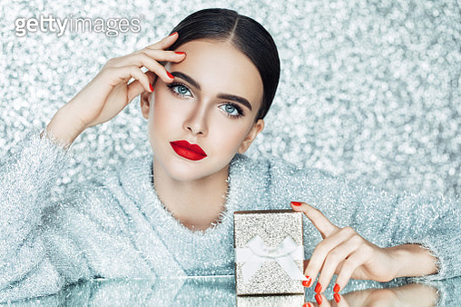 Young woman holding gift box in her hands - gettyimageskorea