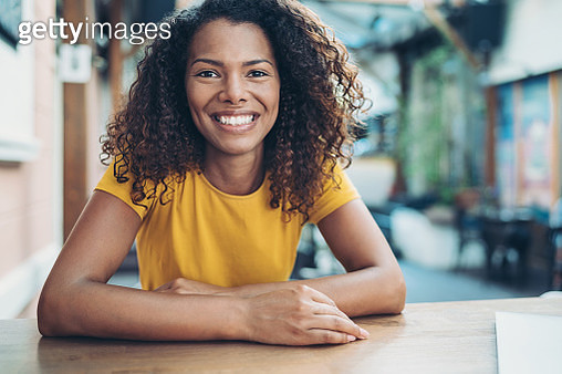 Portrait of a smiling young African ethnicity woman - gettyimageskorea